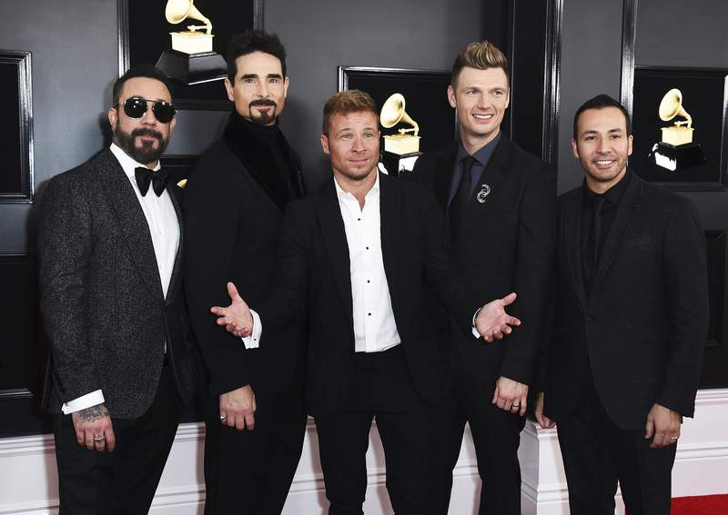 FILE - AJ McLean, from left, Kevin Richardson, Brian Littrell, Nick Carter, and Howie Dorough of The Backstreet Boys appear at the 61st annual Grammy Awards in Los Angeles on Feb. 10, 2019. The pioneering boy band is returning to the Las Vegas Strip with A Very Backstreet Christmas Party, a series of 12 holiday shows at the Planet Hollywood resort this November and December. (Photo by Jordan Strauss/Invision/AP, File)