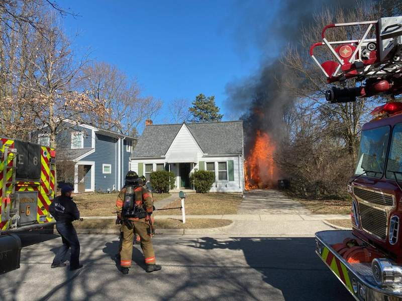 Ann Arbor firefighters and other emergency personnel respond to a garage fire on Ann Arbor's southside on March 12, 2021.