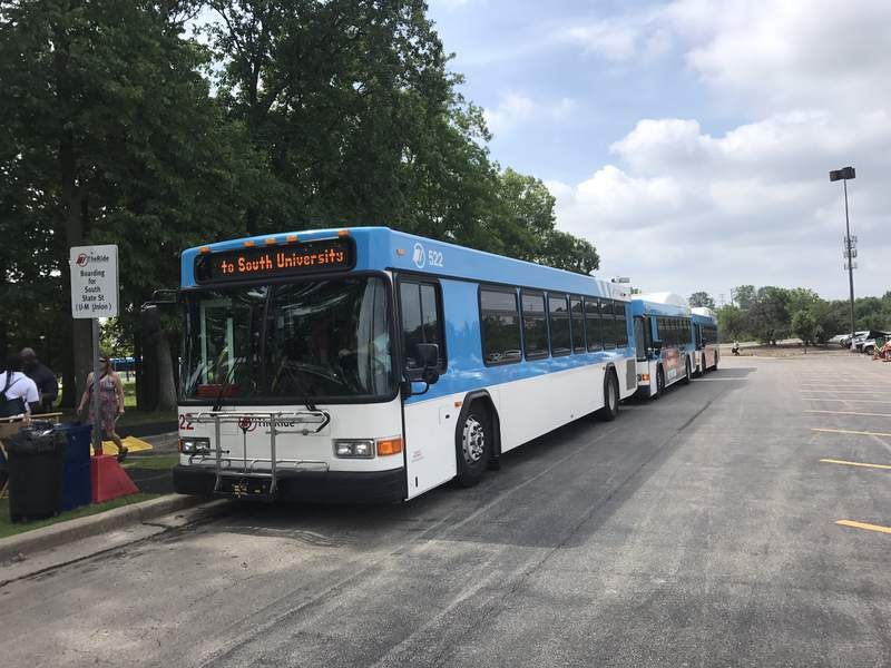 Buses line up at Briarwood Mall to shuttle crowds to the Ann Arbor Art Fair on July 19, 2019.