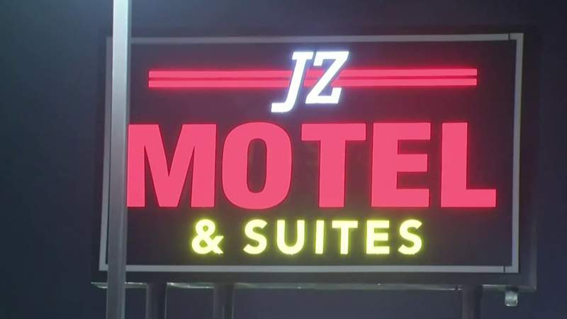 The JZ Motel and Suites sign along 8 Mile Road in Detroit.