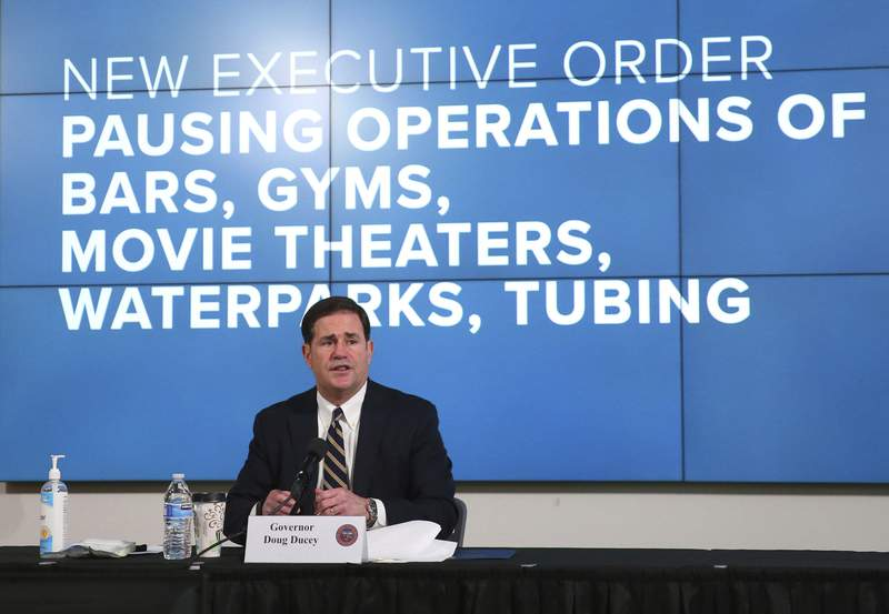 Arizona Gov. Doug Ducey announces a new executive order in response to the rising COVID-19 cases in the state, during a news conference in Phoenix on Monday, June 29, 2020. The governor ordered bars, nightclubs and water parks to close again for at least a month starting Monday night  a dramatic about-face as coronavirus cases surge in the Sunbelt. (Michael Chow/The Arizona Republic via AP, Pool)