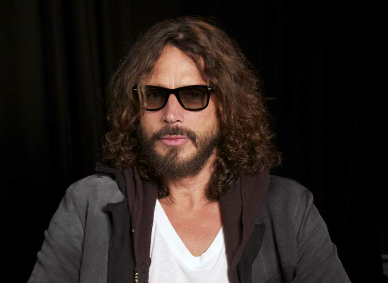 FILE - This Sept. 23, 2011 file photo shows musician Chris Cornell in New York. The family of Chris Cornell and a doctor who they alleged over-prescribed him drugs before he died have agreed to a settle a lawsuit. Documents filed in Los Angeles court by attorneys for the rock singers widow and their children said a confidential settlement had been reached. The documents were filed in April, but had gone unnoticed before City News Service reported on them Thursday, May 6, 2021.  (AP Photo/John Carucci, File)