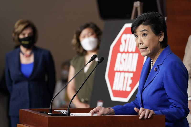 Rep. Judy Chu, D-Calif., right, speaks during a news conference on Capitol Hill in Washington, Tuesday, May 18, 2021, on the COVID-19 Hate Crimes Act as House Speaker Nancy Pelosi of Calif., left, and Rep. Grace Meng, D-N.Y., center, listen. (AP Photo/Susan Walsh)