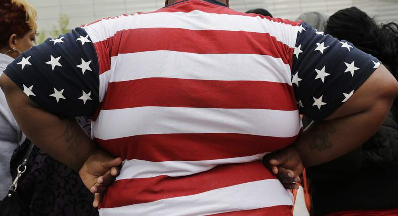 FILE - In this May 8, 2014, file photo, an overweight person is seen in New York. As obesity rates climb in the U.S., more Americans say theyre following special diets compared to a decade ago. (AP Photo/Mark Lennihan, File)