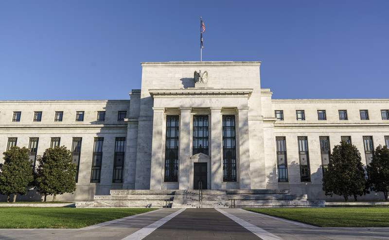FILE - The Federal Reserve is seen in Washington, in this Nov. 16, 2020 file photo. The Federal Reserve reported Monday, March 22, 2021,  that it earned $88.6 billion in 2020 and paid back to the federal government $86.9 billion, the largest Fed payment to the government in four years.  (AP Photo/J. Scott Applewhite, File)