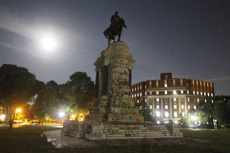 The moon illuminates the statue of Confederate General Robert E. Lee on Monument Avenue Friday June. 5, 2020, in Richmond, Va. The Supreme Court of Virginia ruled Thursday, Sept 2, 2021 that the state can take down an enormous statue that has towered over Monument Avenue in the states capital for more than a century and has become a symbol of racial injustice. (AP Photo/Steve Helber, file)