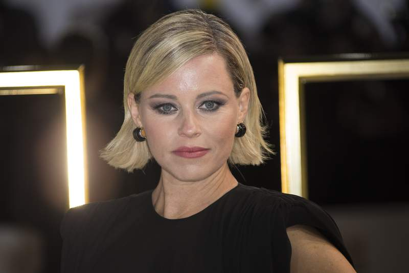 FILE - In this Nov. 20, 2019 file photo, Elizabeth Banks poses for photographers upon arrival at the UK premiere of 'Charlie's Angels', at a central London cinema. Harvard University's famed Hasty Pudding theater troupe has named Banks as the group's 2020 Woman of the Year. The troupe's leaders made the announcement Tuesday, Jan. 14, 2020 saying Banks was chosen because of her impact in Hollywood as a female director, producer and writer. (Photo by Joel C Ryan/Invision/AP, File)