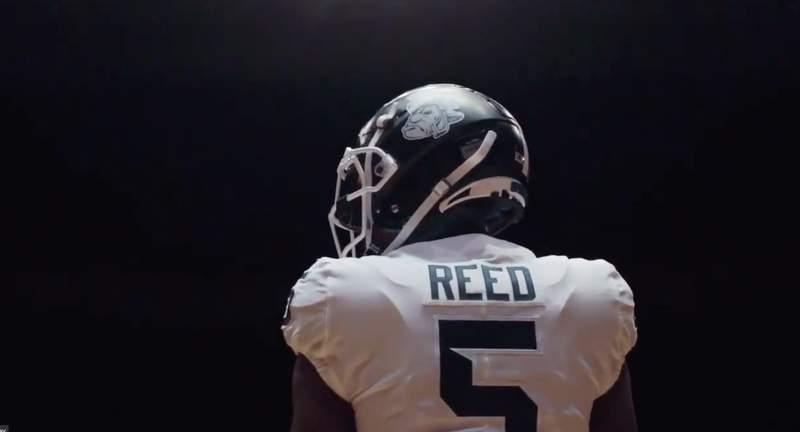 "Michigan State Football uniform with ""Gruff Sparty"" logo on helmet."