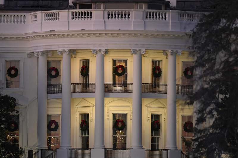 In this Dec. 5, 2019 photo, a view of the south side of the White House in Washington decorated for Christmas. The Associated Press-NORC Center for Public Affairs Researchpoll released Friday finds only about 1 in 10 Americans expect a downturn in their own lives in 2020. But about 4 in 10 say the way things are going nationwide will get worse in the year ahead. 2020 is an election year, and that might have something to do with it: Most Democrats and Republicans alike say they're dissatisfied with the state of politics. (AP Photo/Susan Walsh)