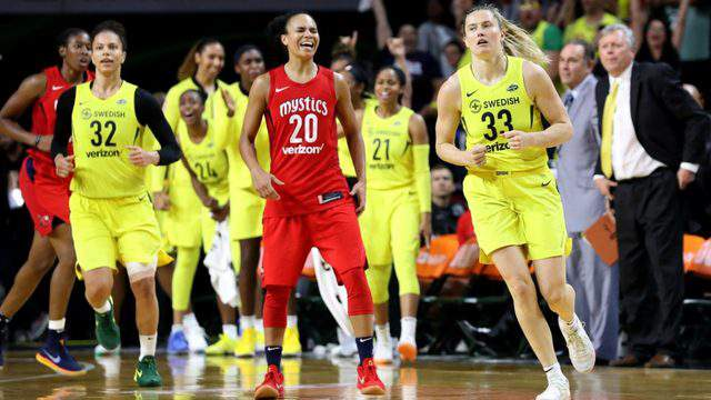 FAIRFAX, VA - SEPTEMBER 12: Sami Whitcomb #33 of the Seattle Storm celebrates after hitting a three pointer in front of Kristi Toliver #20 of the Washington Mystics in the second half during game three of the WNBA Finals at EagleBank Arena on September 12, 2018 in Fairfax, Virginia. (Photo by Rob Carr/Getty Images)