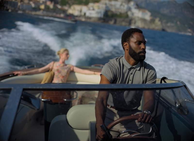 """This image released by Warner Bros. Entertainment shows Elizabeth Debicki, left, and John David Washington in a scene from """"Tenet.""""  (Melinda Sue Gordon/Warner Bros. Entertainment via AP)"""