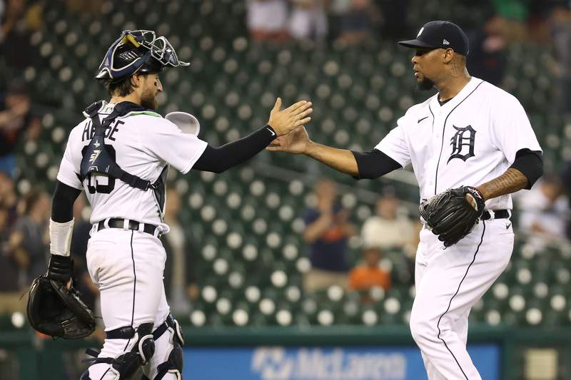DETROIT, MICHIGAN - JUNE 08: Jose Cisnero #67 of the Detroit Tigers celebrates a 5-3 win over the Seattle Mariners with Eric Haase #13 at Comerica Park on June 08, 2021 in Detroit, Michigan. (Photo by Gregory Shamus/Getty Images)