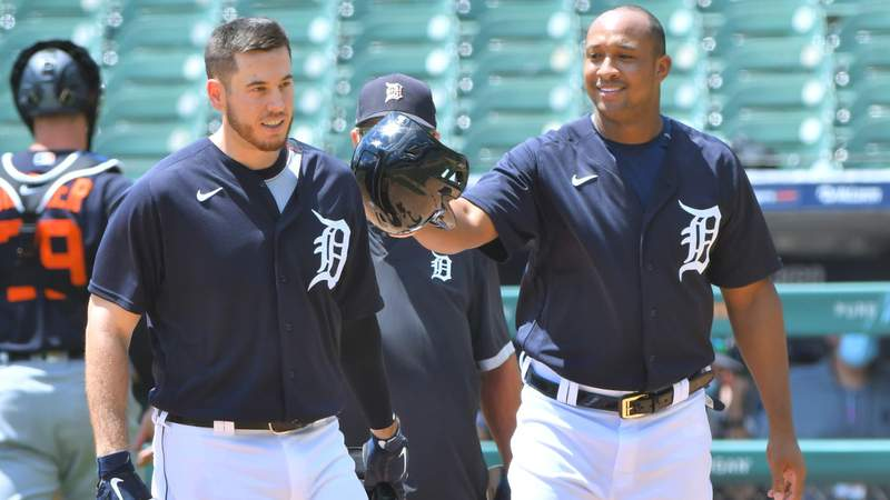C.J. Cron #26 (L) of the Detroit Tigers is greeted at home plate by teammate Jonathan Schoop #8 after he hit a home run during the Detroit Tigers Summer Workouts at Comerica Park on July 11, 2020 in Detroit, Michigan.