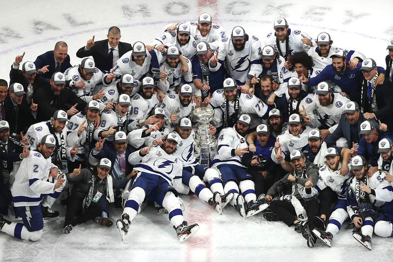 EDMONTON, ALBERTA - SEPTEMBER 28:  The Tampa Bay Lightning pose for their team photo with the Stanley Cup following the series-winning victory over the Dallas Stars in Game Six of the 2020 NHL Stanley Cup Final at Rogers Place on September 28, 2020 in Edmonton, Alberta, Canada. (Photo by Bruce Bennett/Getty Images)