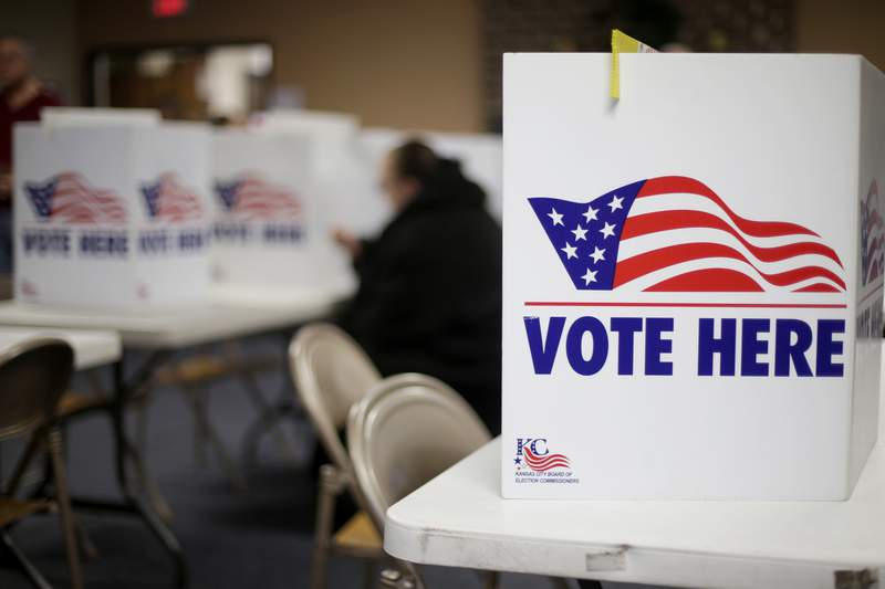 A woman votes in the presidential primary election at the the Summit View Church of the Nazarene Tuesday, March 10, 2020, in Kansas City, Mo. (AP Photo/Charlie Riedel)