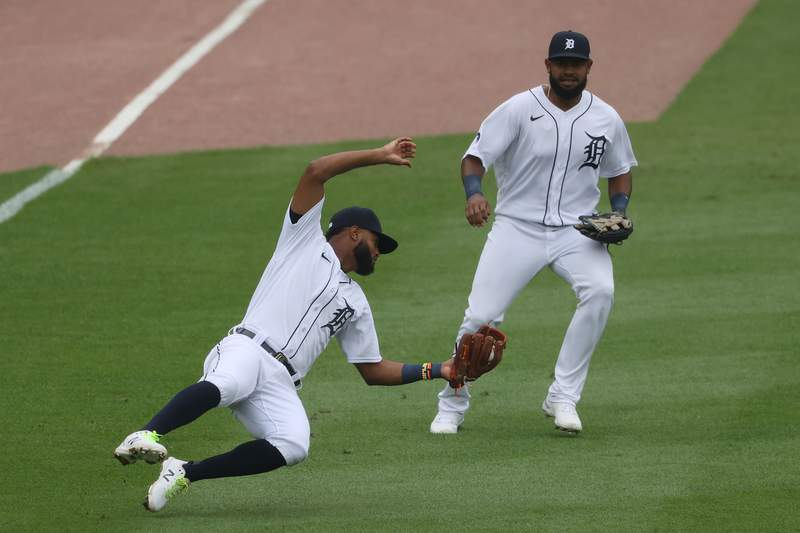 DETROIT, MICHIGAN - SEPTEMBER 09: Willi Castro #49 of the Detroit Tigers makes a catch in front of Jorge Bonifacio #57 while playing the Milwaukee Brewers at Comerica Park on September 09, 2020 in Detroit, Michigan. (Photo by Gregory Shamus/Getty Images)