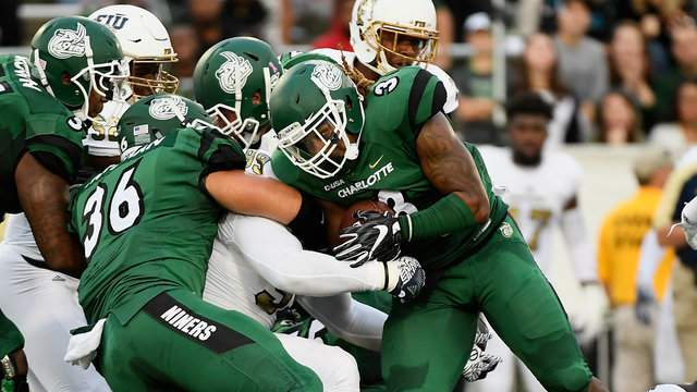 Running back Kalif Phillips #3 of the Charlotte 49ers fights for extra yardage against the FIU Golden Panthers on October 15, 2016 in Charlotte, North Carolina. (Photo by Mike Comer/Getty Images)