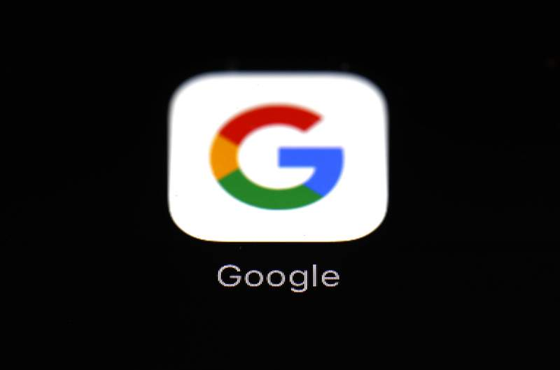 FILE - This March 19, 2018 file photo shows the Google app on an iPad in Baltimore. Google says it won't develop new ways to follow individual users across the internet after it phases out existing ad tracking technology from Chrome browsers in an upcoming overhaul aimed at tightening up privacy. (AP Photo/Patrick Semansky, File)