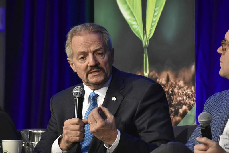"""FILE - In this Oct. 11, 2019, file photo, U.S. Bureau of Land Management Acting Director William """"Perry"""" Pendley speaks at a conference for journalists in Fort Collins, Colo. The former oil industry attorney will continue for now calling the shots at a government agency that oversees nearly a quarter-billion public acres in the U.S. West. That's despite the White House saying over the weekend that President Trump would withdraw the nomination of Pendley. (AP Photo/Matthew Brown, File)"""