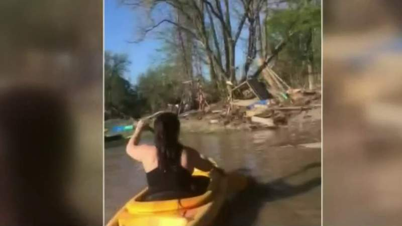 Sanford woman kayaks to floating home swept away by flood to recover mother's ashes