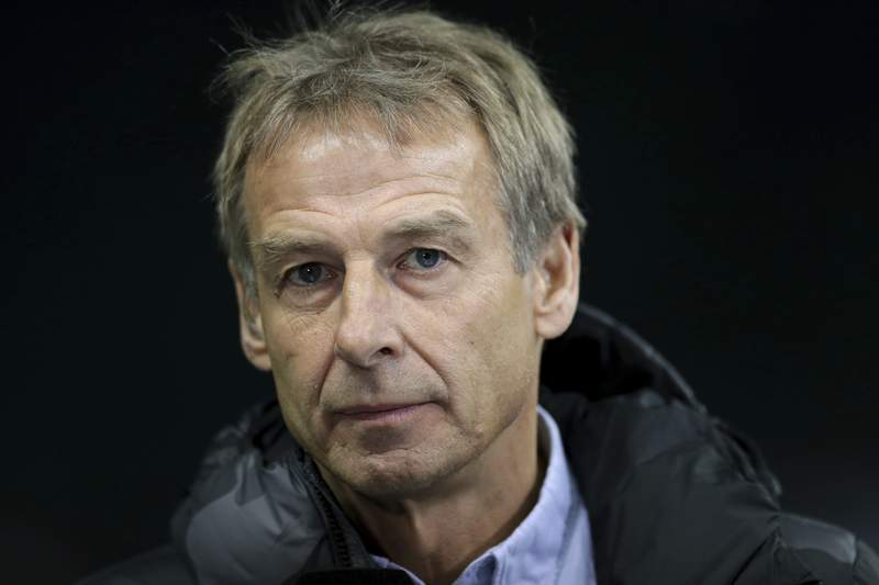 In this Saturday, Dec. 21, 2019 photo Hertha's head coach Juergen Klinsmann listens to a reporter's question during an interview prior to the German Bundesliga soccer match between Hertha BSC Berlin and Borussia Moenchengladbach in Berlin, Germany. (AP Photo/Michael Sohn)