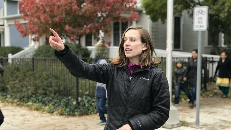 DDA project manager Amber Miller demonstrates how the bike lane works for cyclists and pedestrians on Oct. 27, 2019. (Credit Meredith Bruckner)