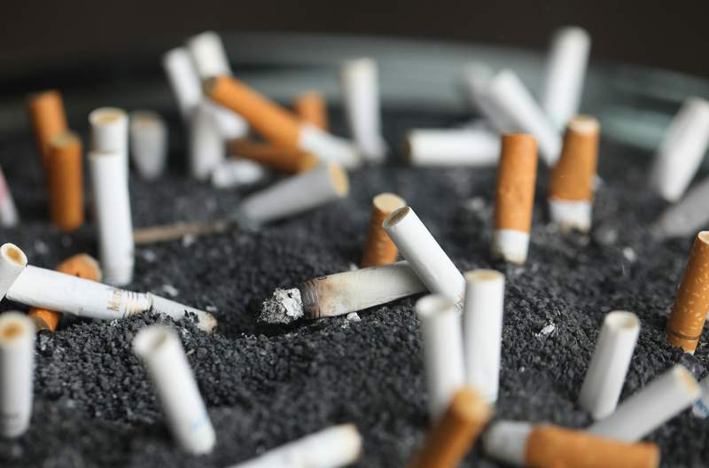 FILE - This March 28, 2019 photo shows cigarette butts in an ashtray in New York. On Tuesday, March 9, 2021. Lung cancer is the nations top cancer killer, causing more than 135,000 deaths each year. Smoking is the chief cause and quitting the best protection. (AP Photo/Jenny Kane, File)