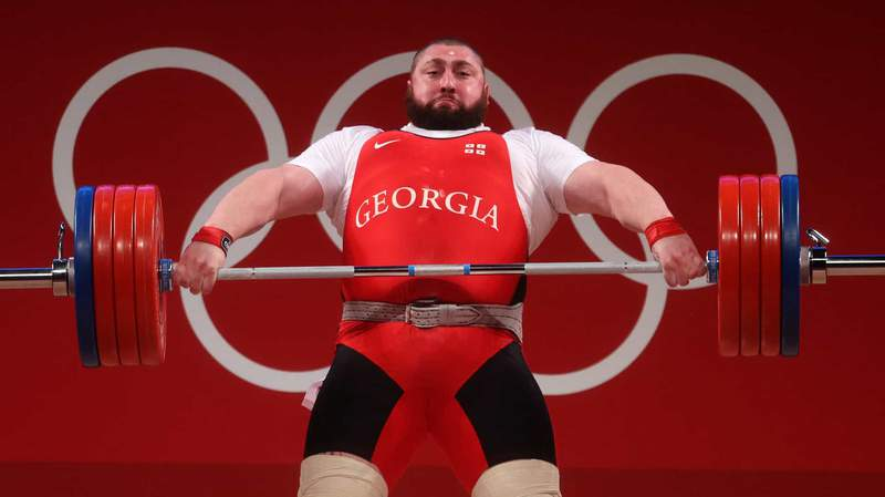 Lasha Talakhadze of Georgia lifts more than anyone has ever lifted on Thursday at the Tokyo Olympics.
