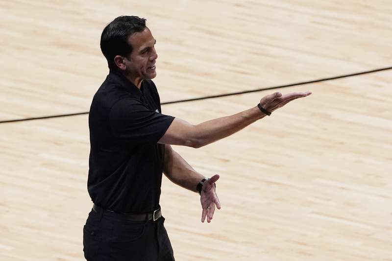Miami Heat coach Erik Spoelstra gestures during the second half of Game 3 of the team's NBA basketball first-round playoff series against the Milwaukee Bucks, Thursday, May 27, 2021, in Miami. (AP Photo/Marta Lavandier)