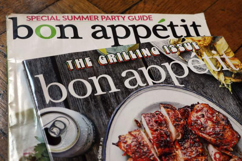 FILE - In this June 10, 2020 file photo, two covers of Bon Appetit magazine are shown in New York. Book-publishing executive Dawn Davis is Bon Appetits new top editor, amid a reckoning on race and culture at the food magazine. Davis, a Black woman, was most recently vice president and publisher of Simon & Schuster imprint 37 Ink. Bon Appetit is one of the main brands of magazine publisher Conde Nast.   (AP Photo/Richard Drew, File)
