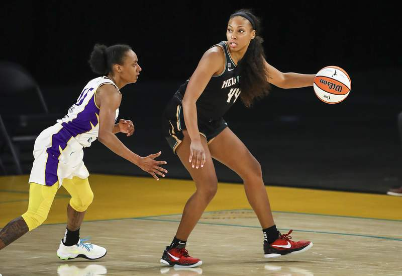 LOS ANGELES, CALIFORNIA - JUNE 20: Guard/forward Betnijah Laney #44 of the New York Liberty handles the ball defended by guard Brittney Sykes #15 of the Los Angeles Sparks at Los Angeles Convention Center on June 20, 2021 in Los Angeles, California. NOTE TO USER: User expressly acknowledges and agrees that, by downloading and or using this photograph, User is consenting to the terms and conditions of the Getty Images License Agreement. (Photo by Meg Oliphant/Getty Images)