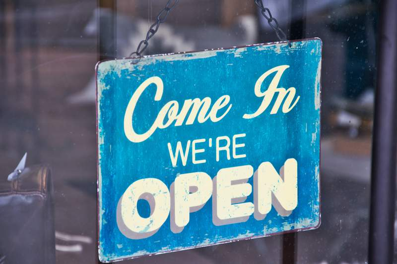An open sign in the window of a business.