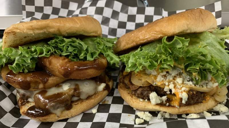 Two of the mouth-watering burgers that have made City Burger such a hit.