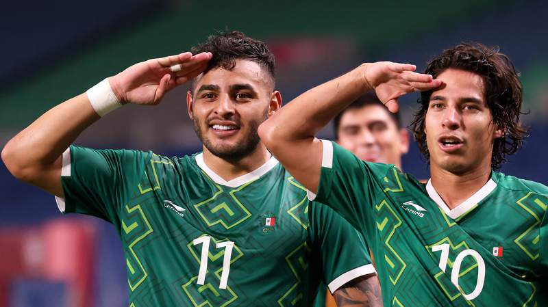 Alexis Vega and Diego Lainez after Vega scored Mexico's third goal during the Men's Bronze Medal Match against Japan at the 2020 Olympics.