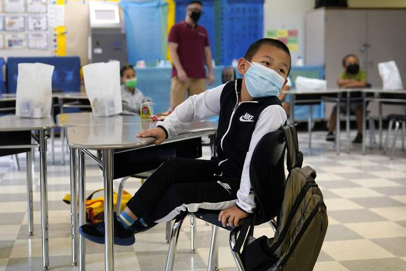 A summer school student wears a protective mask in class at the E.N. White School in Holyoke, Mass., on Wednesday, Aug. 4, 2021. (AP Photo/Charles Krupa)