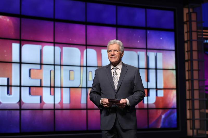 """Alex Trebek, who presided over the beloved quiz show """"Jeopardy!"""" for more than 30 years with dapper charm and a touch of school-master strictness, died Sunday. He was 80."""