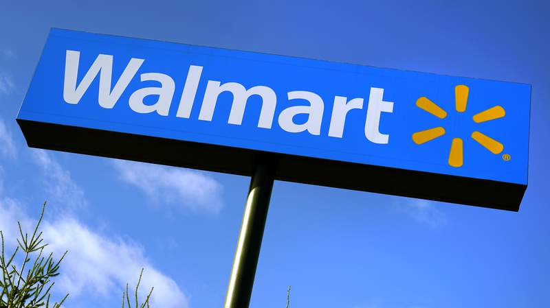 FILE - In this Nov. 18, 2020 file photo, a Walmart store sign is visible from Route 28 in Derry, N.H. Walmart Inc., reported on Thursday, Feb. 18, 2021, that it swung to a loss in the fiscal fourth quarter as the sale of its Japan and United Kingdom divisions weighed on results. (AP Photo/Charles Krupa, File)