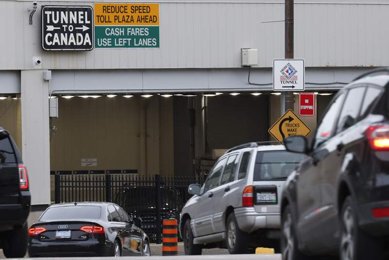 Vehicles enter the Detroit-Windsor Tunnel to travel to Canada in Detroit, Monday, March 16, 2020. (AP Photo/Paul Sancya)