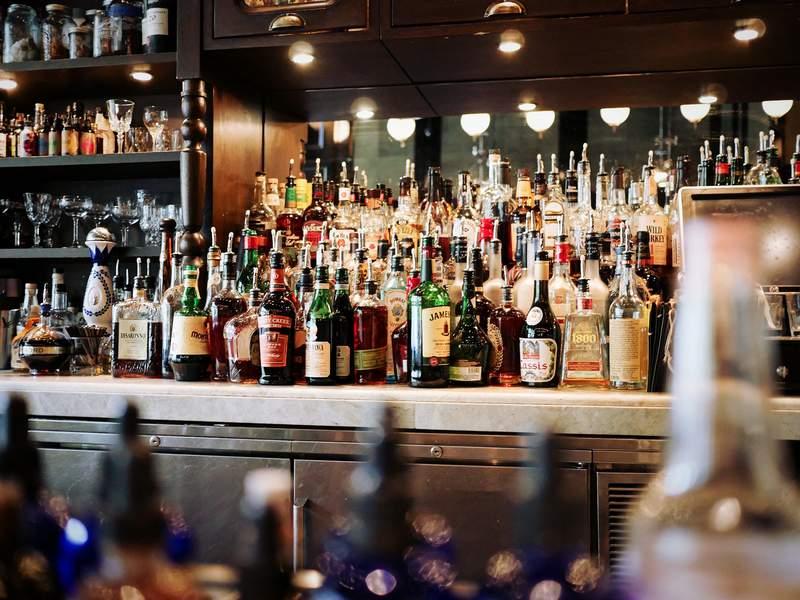 The liquor selection at a bar.