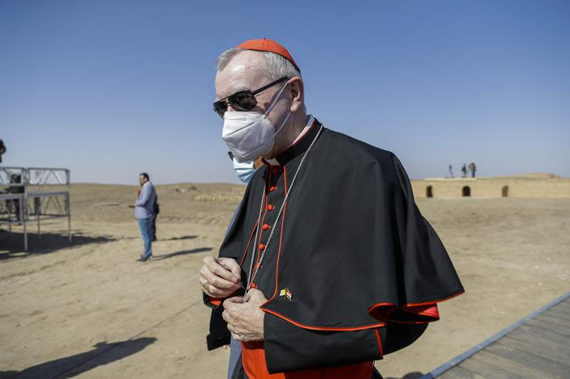 FILE - In this file photo taken on March 6, 2021, Vatican Secretary of State Cardinal Pietro Parolin arrives ahead of an interreligious meeting with Pope Francis near the archaeological area of the Sumerian city-state of Ur, 20 kilometers south-west of Nasiriyah, Iraq. The Vatican No. 2 is skipping a planned trip to Venezuela this week because of the coronavirus pandemic. Cardinal Pietro Parolin, the Vaticans former ambassador to Caracas, had planned to celebrate the April 30 beatification of Jose Gregorio Hernandez, dubbed the doctor of the poor. The Vatican said Wednesday that due to issues linked to the pandemic, Parolin wouldnt make the trip. (AP Photo/Andrew Medichini/FILE)