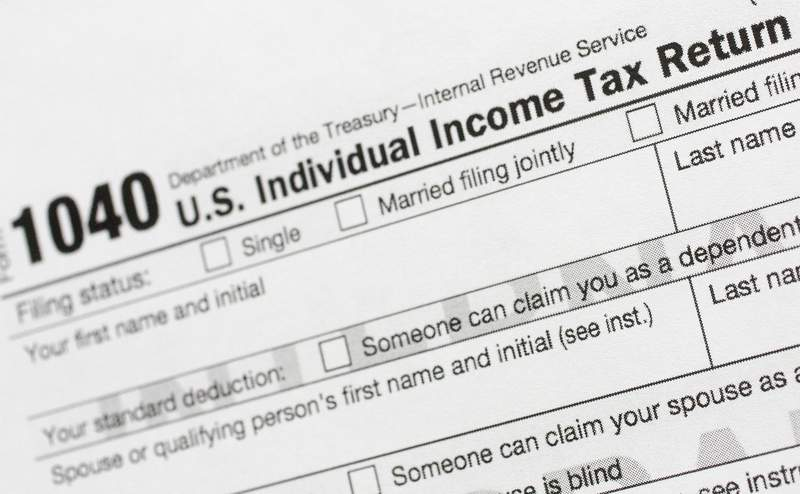 FILE - This July 24, 2018, file photo shows a portion of the 1040 U.S. Individual Income Tax Return form. Its the time of year to start thinking about taxes - what's ahead and what can be done now to manage. But the upcoming tax filing season is going to be trickier for many Americans due to rampant unemployment, working from home and general upheaval due to COVID-19. (AP Photo/Mark Lennihan, File)
