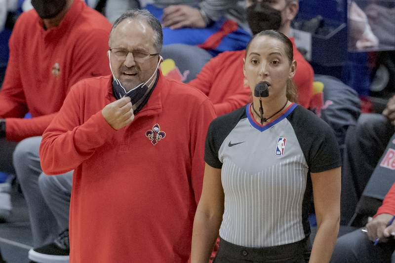 New Orleans Pelicans coach Stan Van Gundy watches the team during the first half of an NBA basketball game against the Cleveland Cavaliers in New Orleans, Friday, March 12, 2021. (AP Photo/Matthew Hinton)
