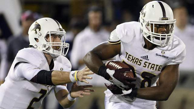 Quarterback Tyler Jones of the Texas State Bobcats hands off to running back Robert Lowe as they take on the Georgia Southern Eagles during the first quarter on October 29, 2015 at Paulson Stadium in Statesboro. (Photo by Todd Bennett/Getty Images)