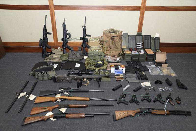 FILE - This undated file image provided by the Maryland U.S. District Attorney's Office shows a photo of firearms and ammunition that was in the motion for detention pending trial in the case against Coast Guard lieutenant Christopher Hasson, accused of stockpiling guns and targeting Supreme Court justices, prominent Democrats and TV journalists. Hassons defense attorneys filed a notice of appeal on Tuesday, Feb. 11, 2020, less than two weeks after U.S. District Judge George Hazel sentenced the 50-year-old man to 160 months in prison. (Maryland U.S. District Attorney's Office via AP, File)