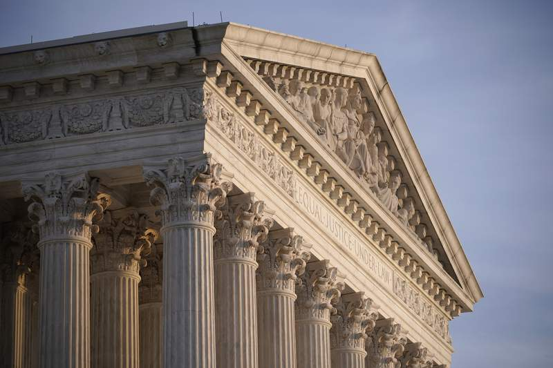 FILE - In this Nov. 5, 2020, file photo the Supreme Court is seen in Washington. With abortion and guns already on the agenda, the conservative-dominated Supreme Court is considering adding a third blockbuster issue _ whether to ban consideration of race in college admissions.  (AP Photo/J. Scott Applewhite, File)