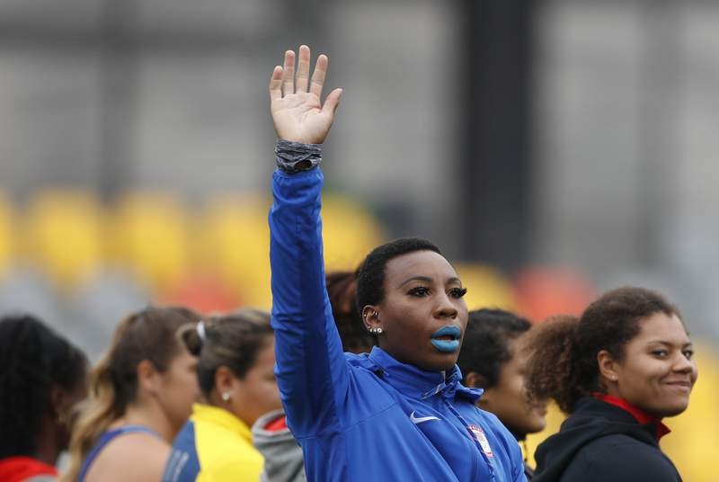 """FILE - In this Aug. 10, 2019, file photo, Gwendolyn """"Gwen"""" Berry of the United States waves as she is introduced at the start of the women's hammer throw final during athletics competition at the Pan American Games in Lima, Peru. Berry has won a humanitarian award for her outspoken role in raising social-justice issues in the United States. The 31-year-old hammer thrower wins the Toyota Humanitarian Award, given annually by USA Track and Field. She's being honored for her role in the debate about social inequality on and off the playing field for the past 16 months.  (AP Photo/Rebecca Blackwell, File)"""