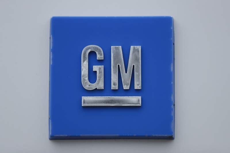 FILE - In this Jan. 27, 2020 file photo, a GM logo is shown at the General Motors Detroit-Hamtramck Assembly plant in Hamtramck, Mich. General Motors, the Detroit automaker making an aggressive push into electric vehicles, is establishing a goal of becoming carbon neutral in both its global products and its operations by 2040.  (AP Photo/Paul Sancya, File)