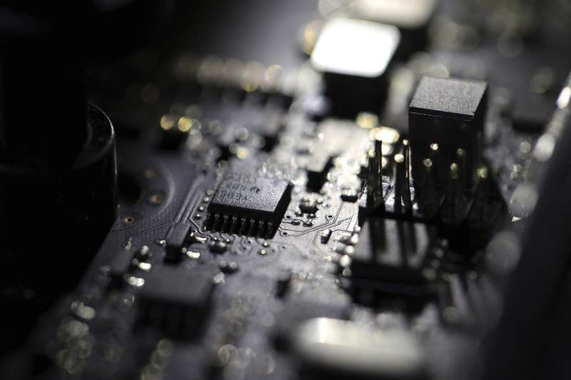 FILE - This Feb 23, 2019, file photo shows the inside of a computer. For 21 years, the software company Kaseya labored in relative obscurity, at least until cybercriminals exploited it in early July 2021 for a massive ransomware attack that snarled businesses around the world and escalated U.S.-Russia diplomatic tensions. (AP Photo/Jenny Kane, File)