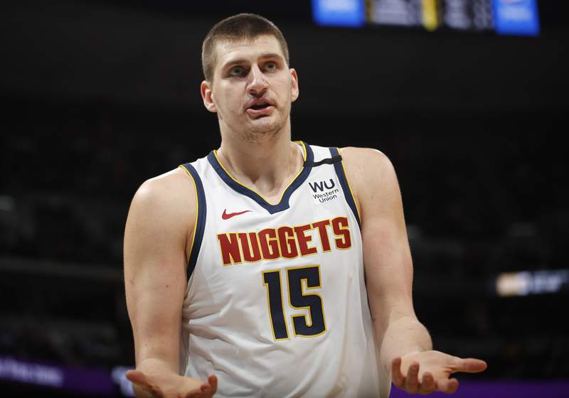 Denver Nuggets center Nikola Jokic argues after being called for a foul against the Milwaukee Bucks in the first half of an NBA basketball game Monday, March 9, 2020, in Denver. (AP Photo/David Zalubowski)