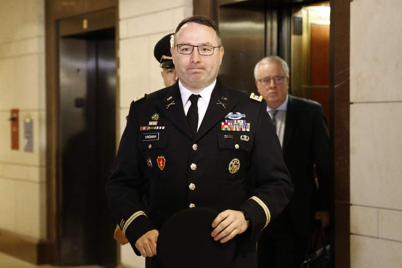 FILE - In this Oct. 29, 2019, file photo, Army Lt. Col. Alexander Vindman, a military officer at the National Security Council, center, arrives on Capitol Hill in Washington. Vindman is set to deliver public testimony about President Donald Trumps alleged attempt to pressure Ukraine to investigate a political rival. Democrats and Republicans are expected to press contrasting narratives about the 20-year Army veterans decision to come forward to allege abuse of power by his commander-in-chief. (AP Photo/Patrick Semansky, File)